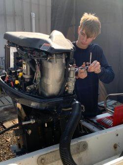 Nicholas Jones working at Midcoast Performance Marine